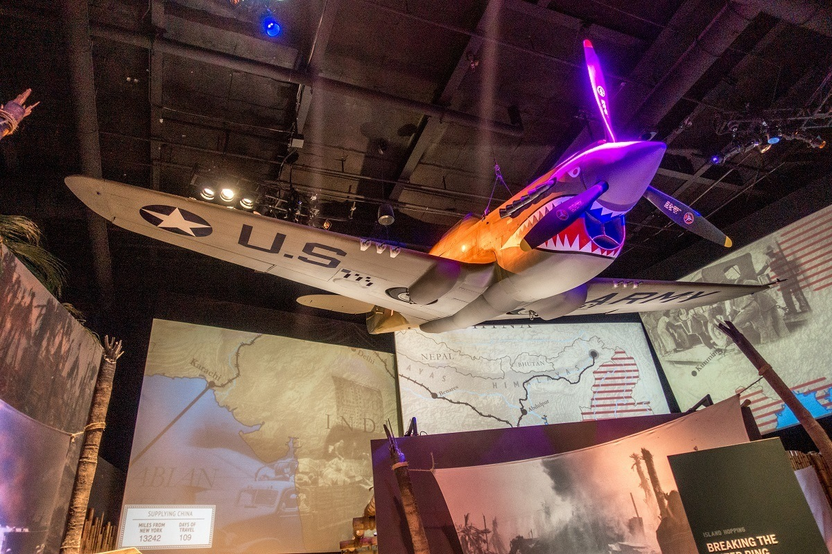 Warhawk plane hanging from ceiling at the National World War II museum
