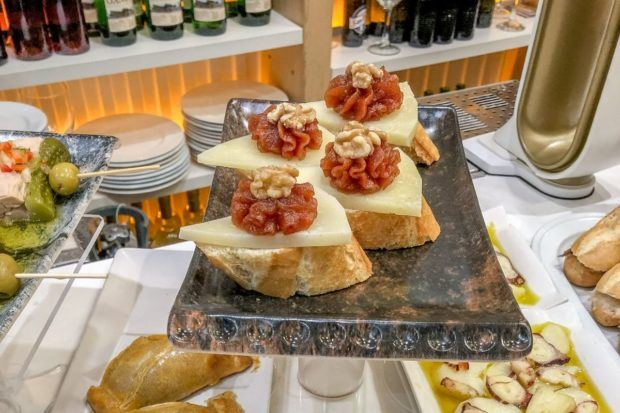 Idiazabal cheese served with quince paste and walnuts is one of the popular pintxos in the Basque Country (often erroneously called San Sebastian tapas)