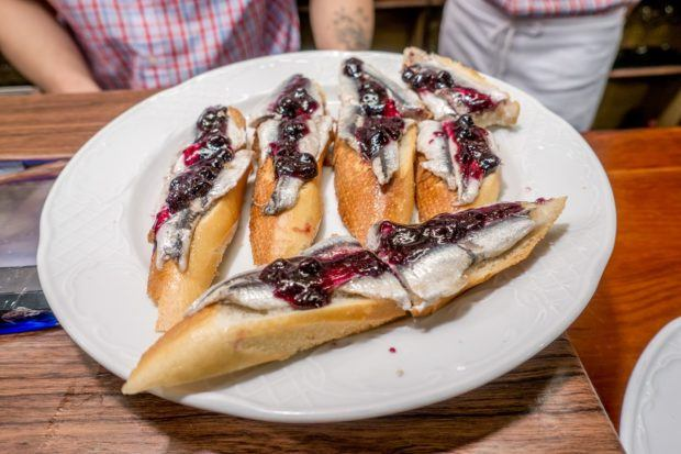 Anchovies topped with blueberry jam on a plate--not something you find at every pinchos bar in the Basque Country