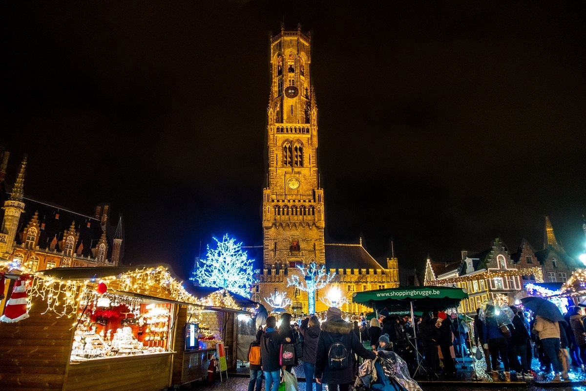 The bell tower soars over the stalls of the Bruges Xmas markets