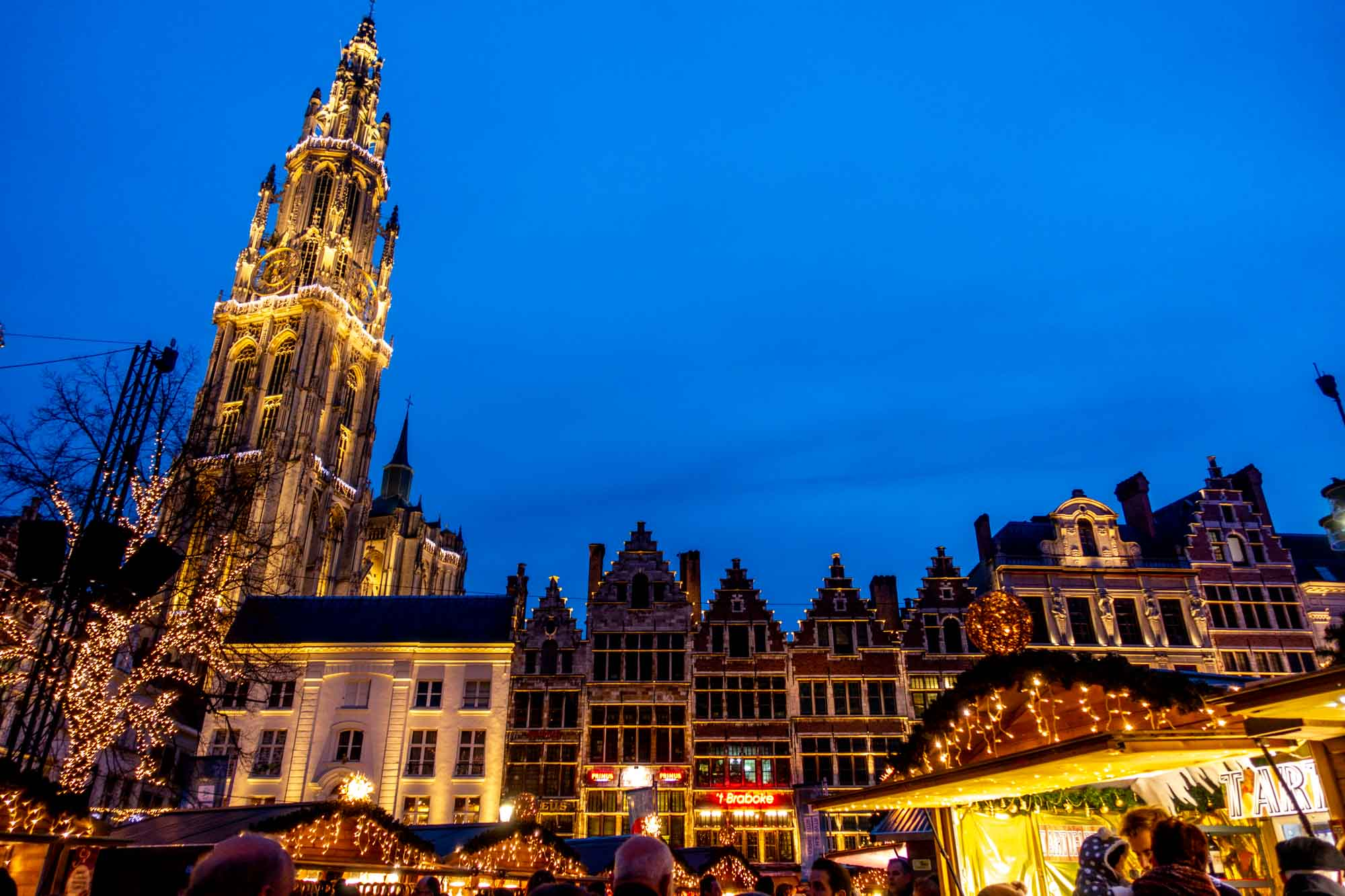 Stalls and the Cathedral of Our Lady at the Antwerp, Belgium, Christmas market