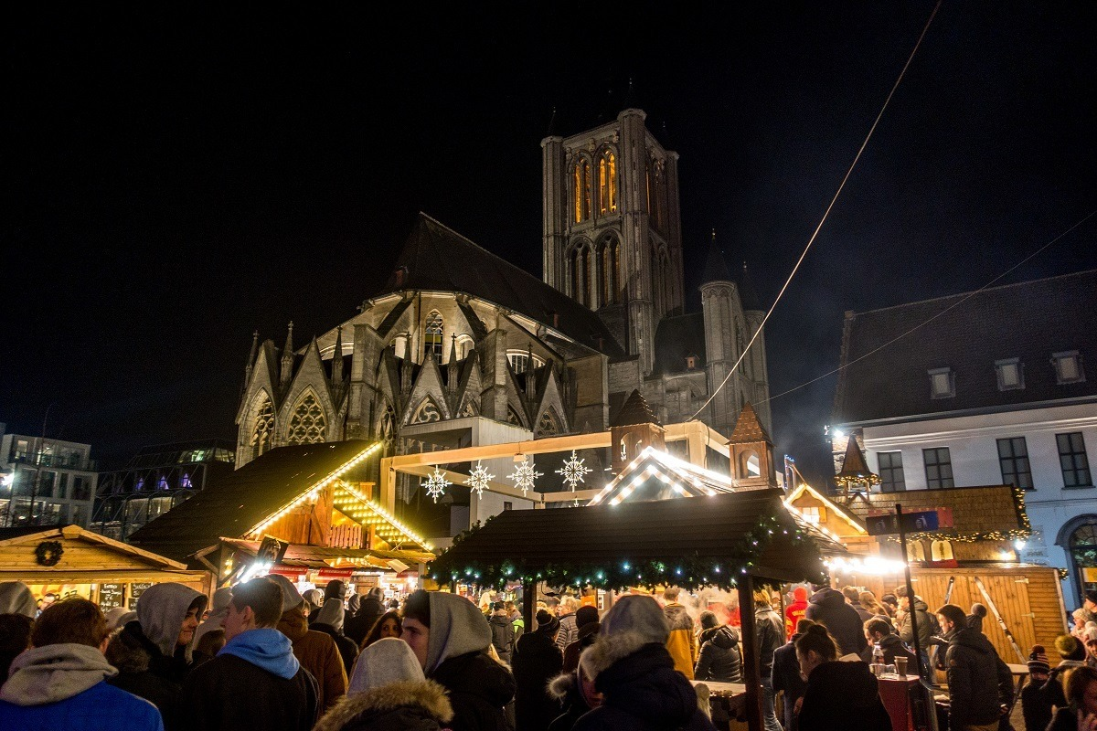 Christmas market stalls by St Nicholas Church in Gent, Belgium