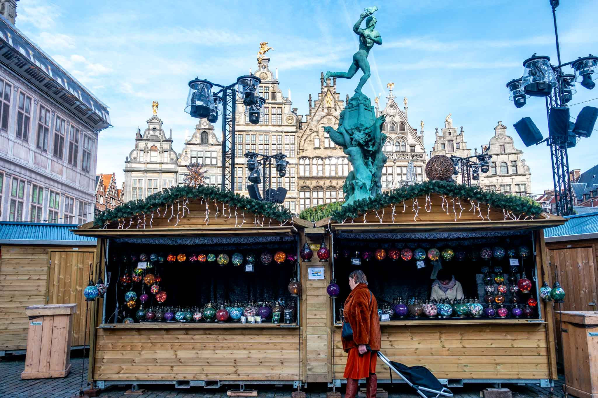 Woman shopping at the vendors in Grote Markt at the Antwerp Christmas market
