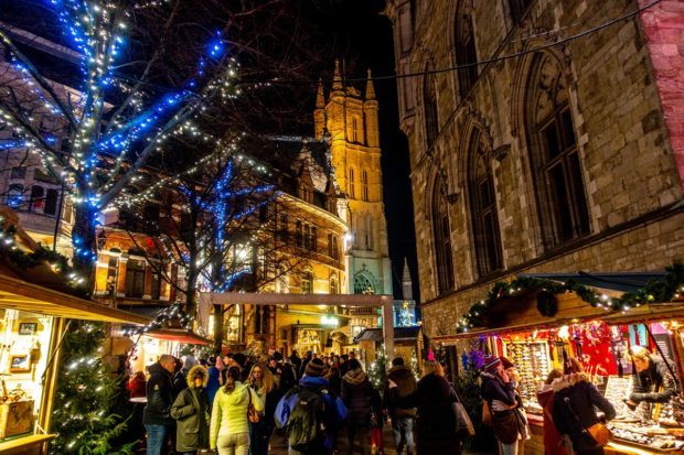 Vendors and shoppers in the streets of Ghent, Belgium, at Christmas