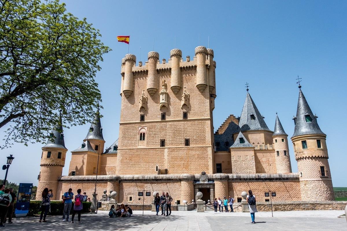 Exterior of Alcazar de Segovia with turrets and Spanish flag