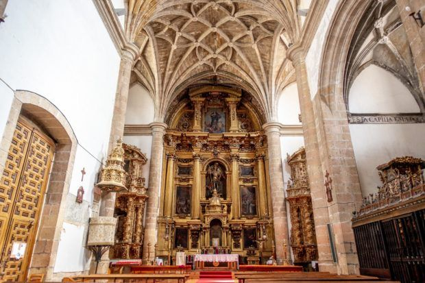 The golden altar and vaulted ceiling of San Miguel Church in Segovia, Spain