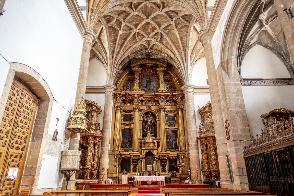 Golden altar and vaulted ceiling of San Miguel Church in Segovia, Spain