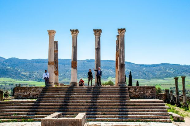 Steps and pillars of the Capitoline Temple in Volubilis. A visit here is a highlight of Morocco travel.