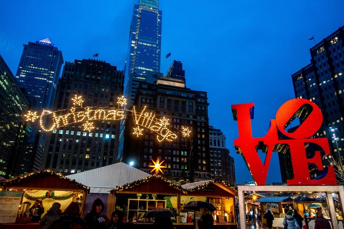 The Christmas market set up in LOVE Park with park sign