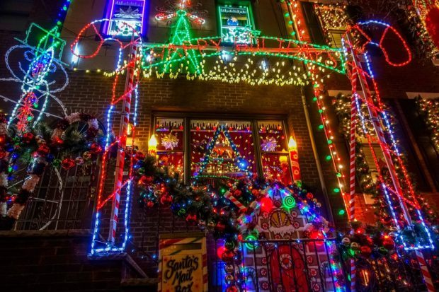 House lit up with numerous brightly colored lights as part of the Miracle on 13th Street, a display that is what to see in Philadelphia at Christmas