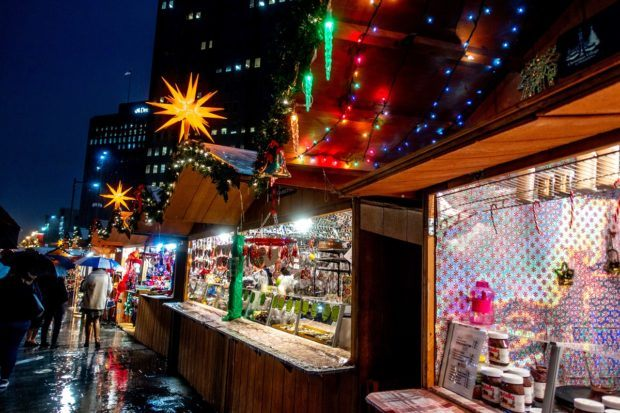 Stands lit up at night at the Christmas Village, a traditional German Christmas market that's one of the best places to visit in Philadelphia PA at the holidays