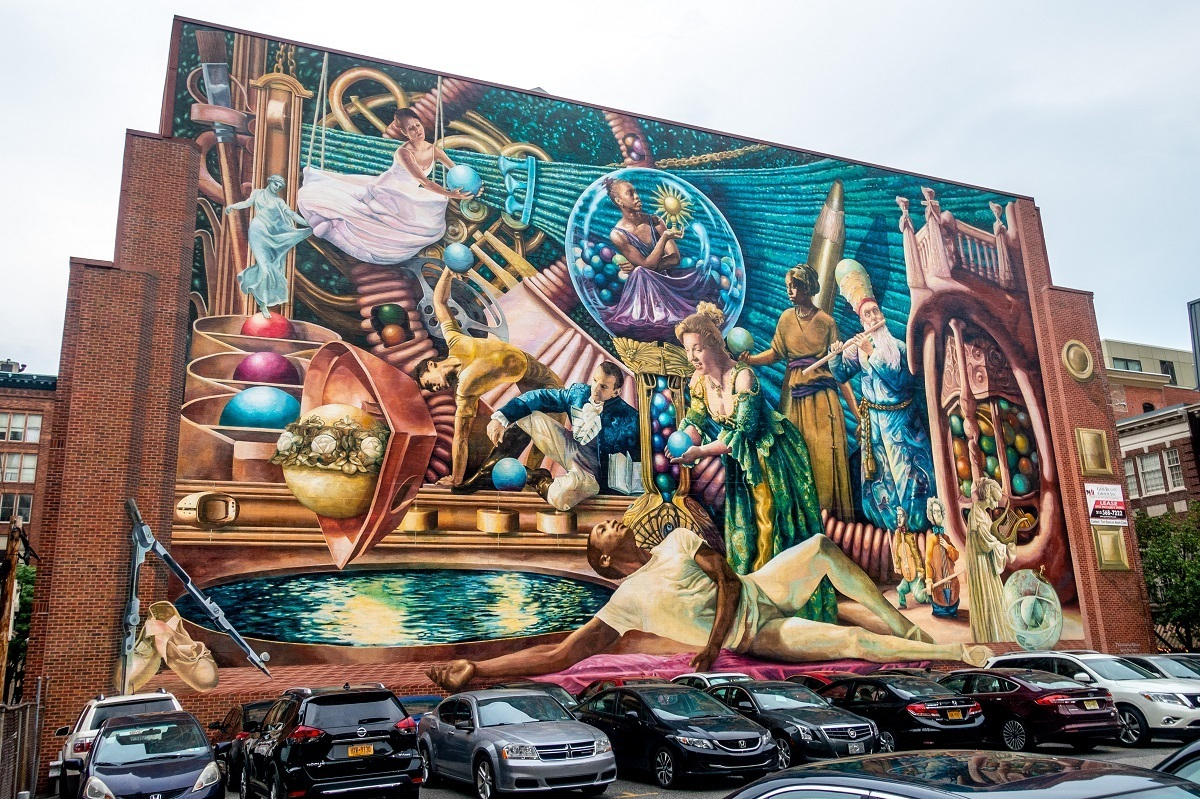 Street art mural depicting the classical muses