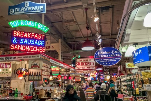 Signs inside Reading Terminal Market. A visit here is one of the best things to do in Philly.