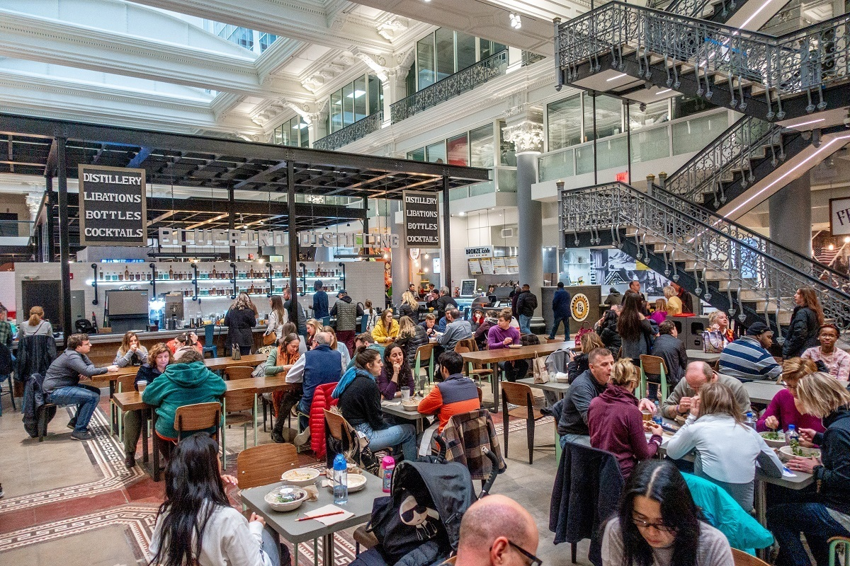 People eating in the Bourse food hall