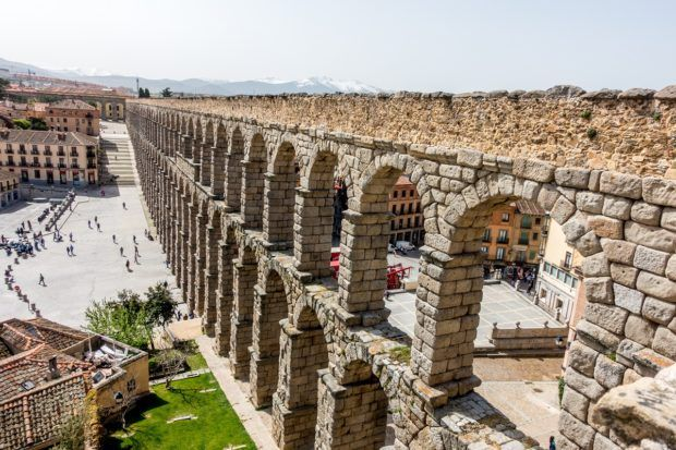 The aqueduct of Segovia extends to the horizon. The UNESCO site is one of the top things to see on a Madrid to Segovia day trip.
