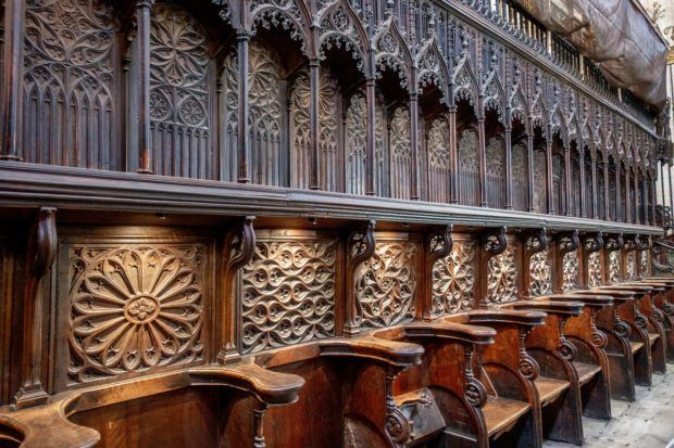 The ornately-carved wooden choir inside the Segovia Cathedral, a 16th-century UNESCO World Heritage Site in Spain