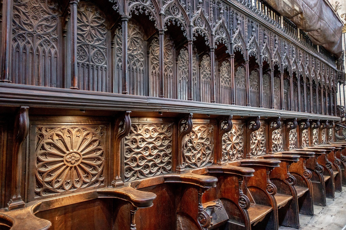 Ornately-carved wooden choir seating inside the Segovia Cathedral