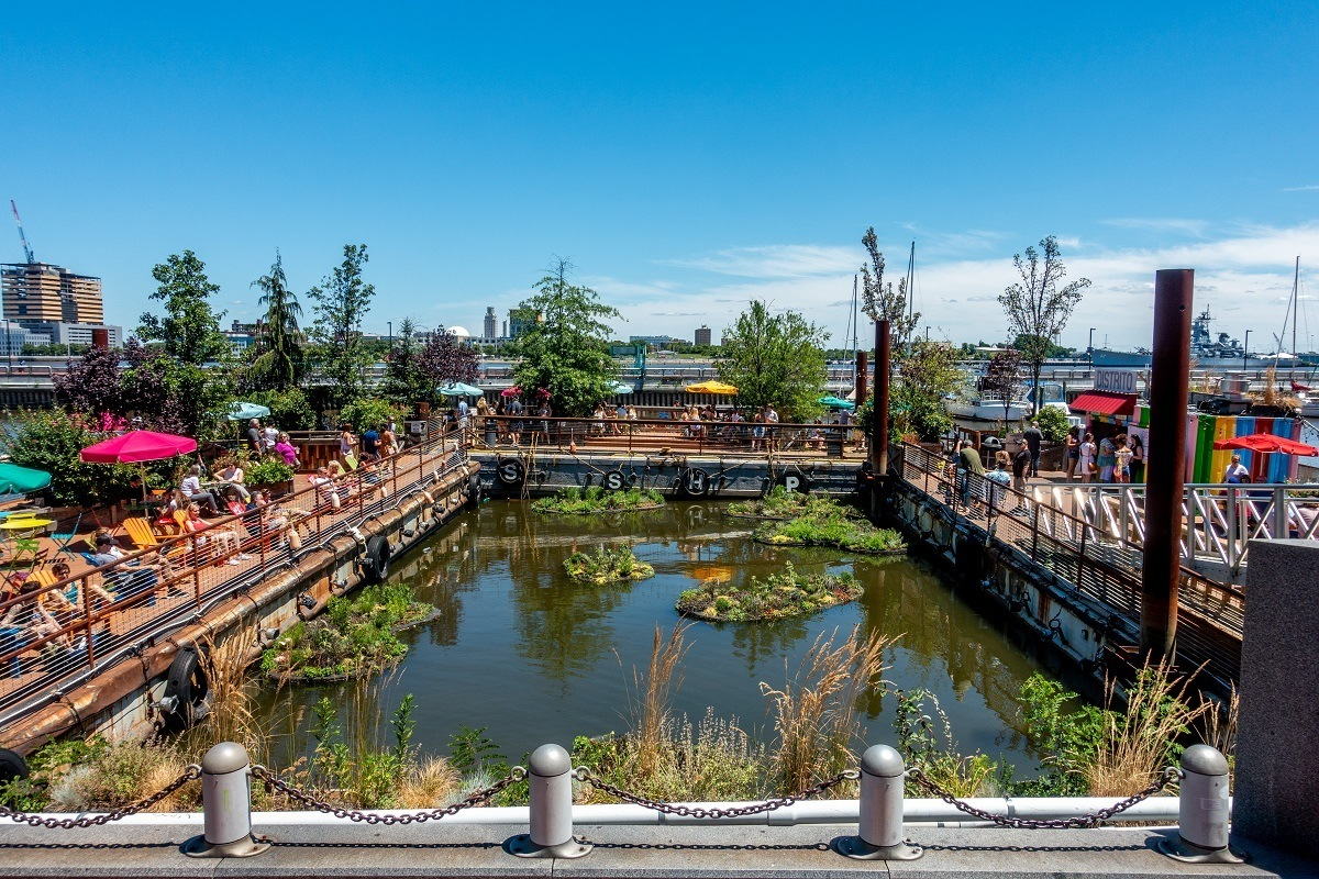 People enjoying floating Spruce Street Harbor Park in Philadelphia