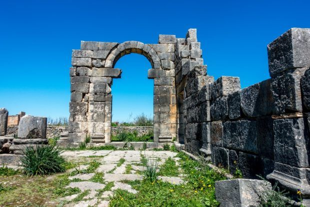 Arch and wall in Volubilis, one of the ancient Morocco historical sites