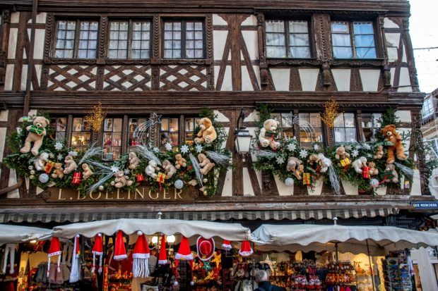 Stuffed animal decorations on the exterior of a half-timbered building in Strasbourg France at Christmas