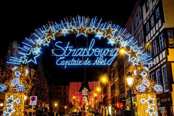 Colorful lights welcome visitors to the Strasbourg Christmas market in France, the Capitale de Noel