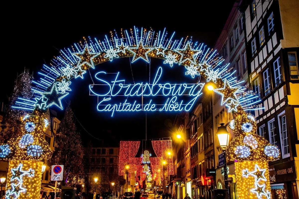 Colorful lights welcome visitors to the Strasbourg Christmas market in France