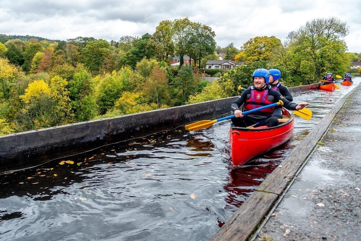 Kayaker paddling over Pontcysyllte Aqueduct in Wales