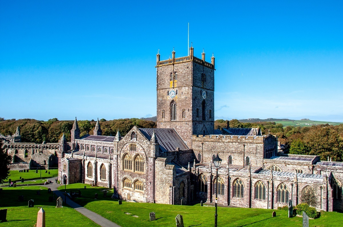 A large stone cathedral with arches and a bell tower, St. Davids Cathedral is one of the beautiful places in Wales