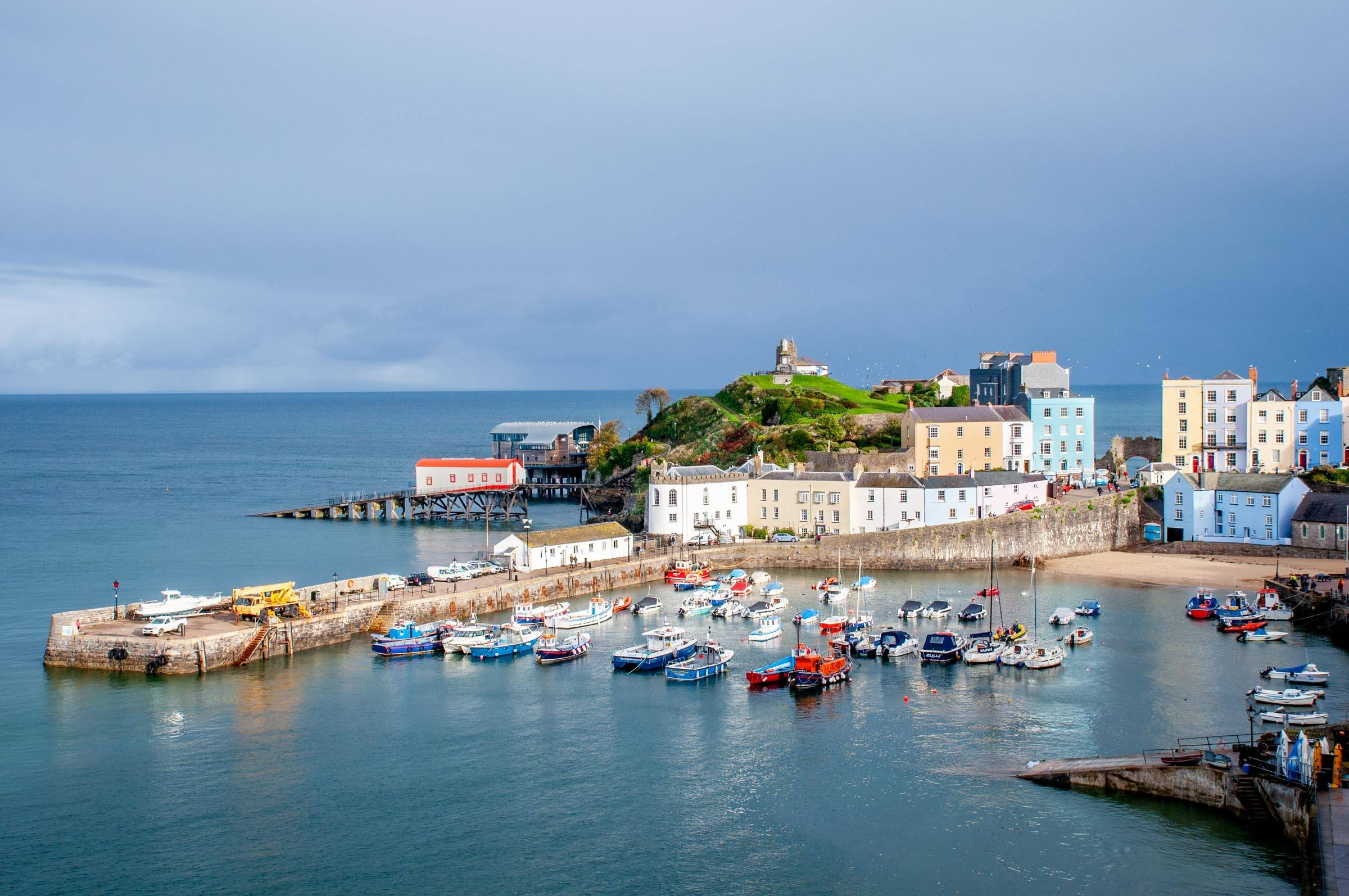 Boats and colorful houses in the harbor of Tenby, Wales
