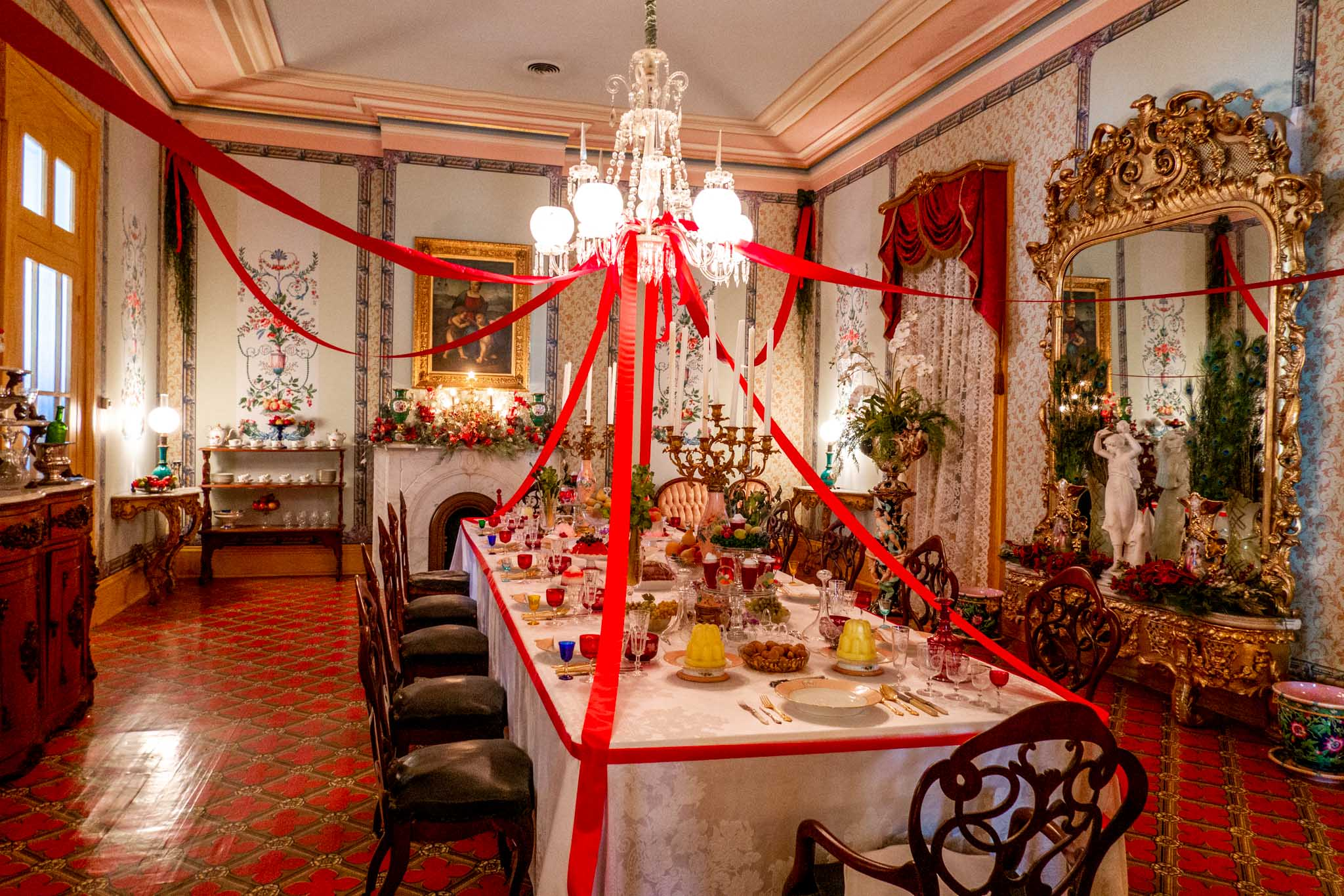 Formal dining room with set table and Christmas decorations at Belmont Mansion in Nashville TN