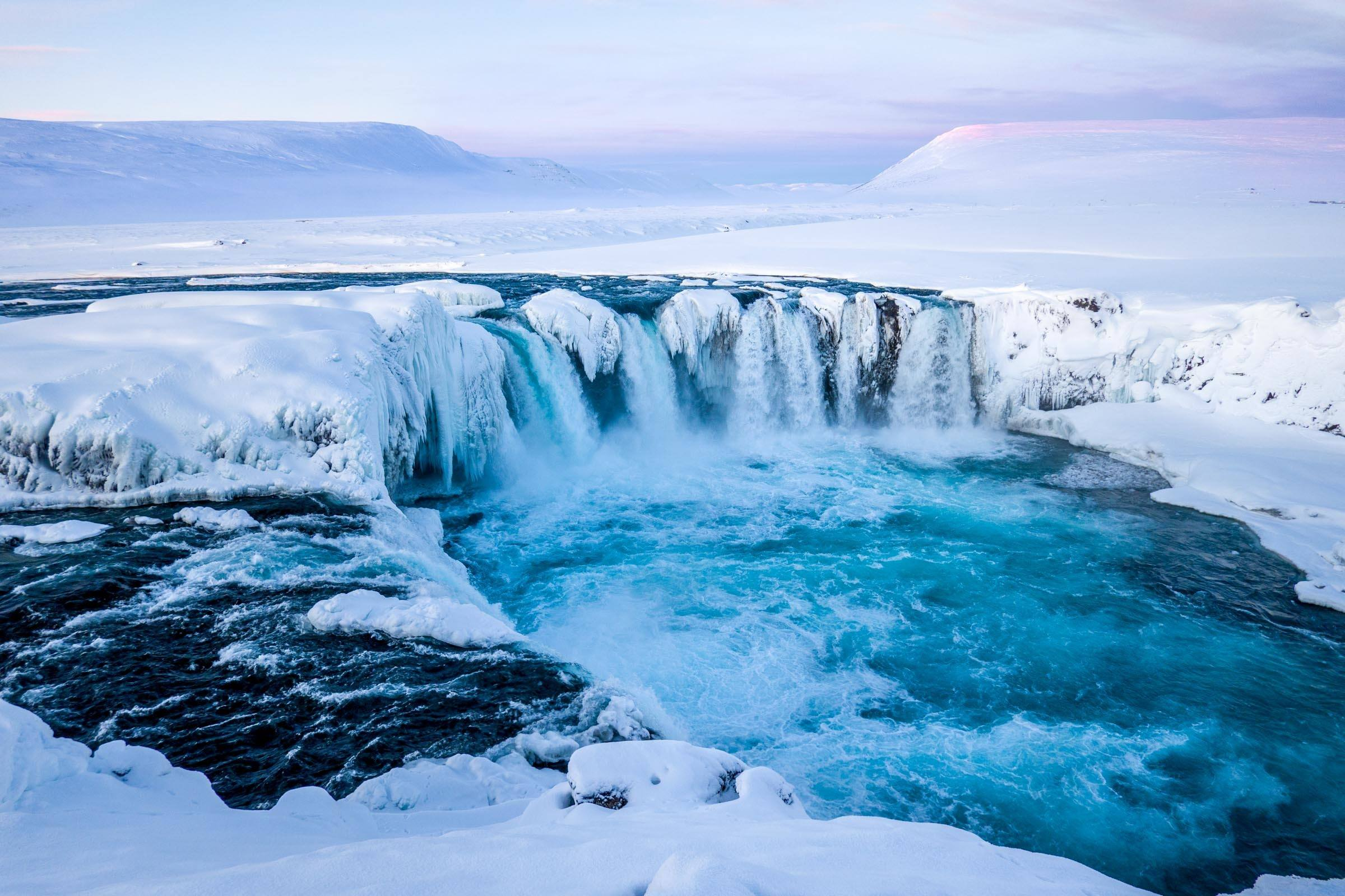 Iceland is beautiful and mysterious. For us, winter may be the best time to visit Iceland. The short days of daylight play tricks on the ice and the snow, like the Godafoss waterfall in the north.