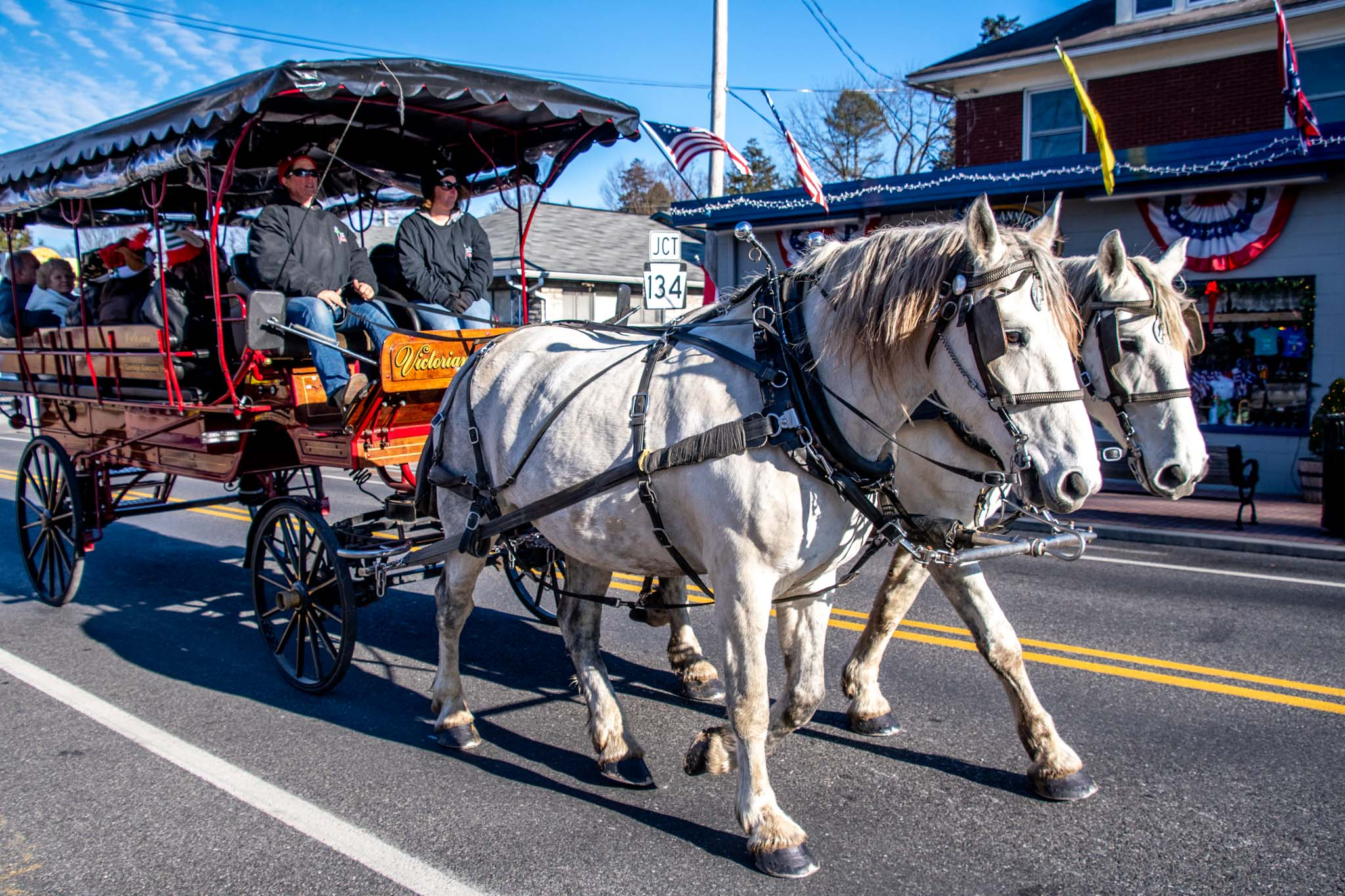 Horse-drawn carriage carries visitors in the streets of Gettysburg at Christmas