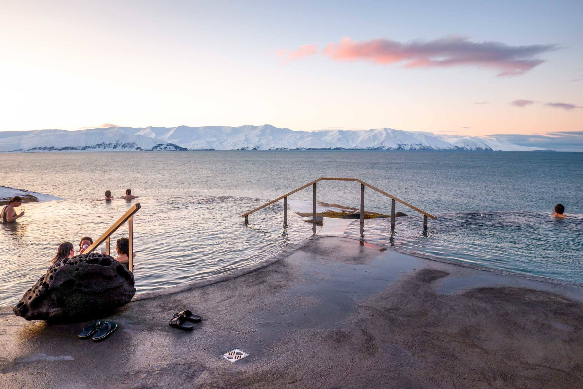 Bathers in the infinity pool at the Geosea Geothermal Sea Baths in Husavik.