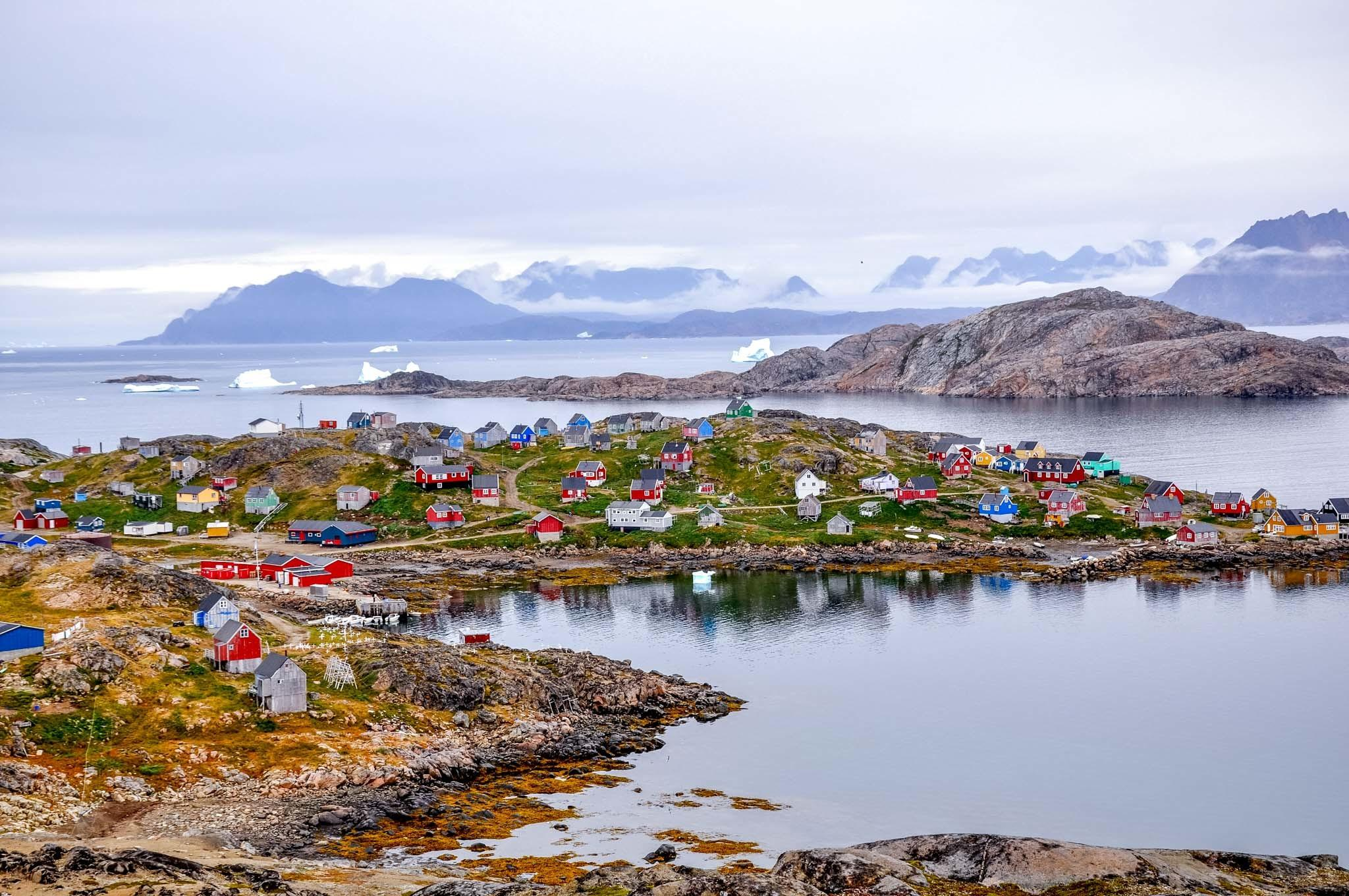 Harbor and colorful homes in Kulusuk, Greenland, a short flight from Iceland.