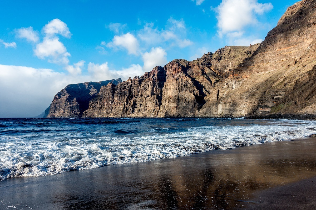 The cliffs of Los Gigantes slope down to the ocean overlooking the black sand beach on Tenerife