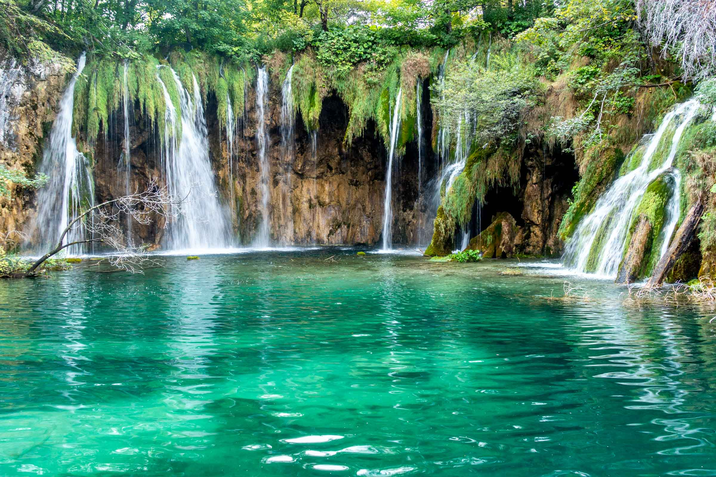Waterfalls falling into lake at Pltvice Lakes National Park in Croatia