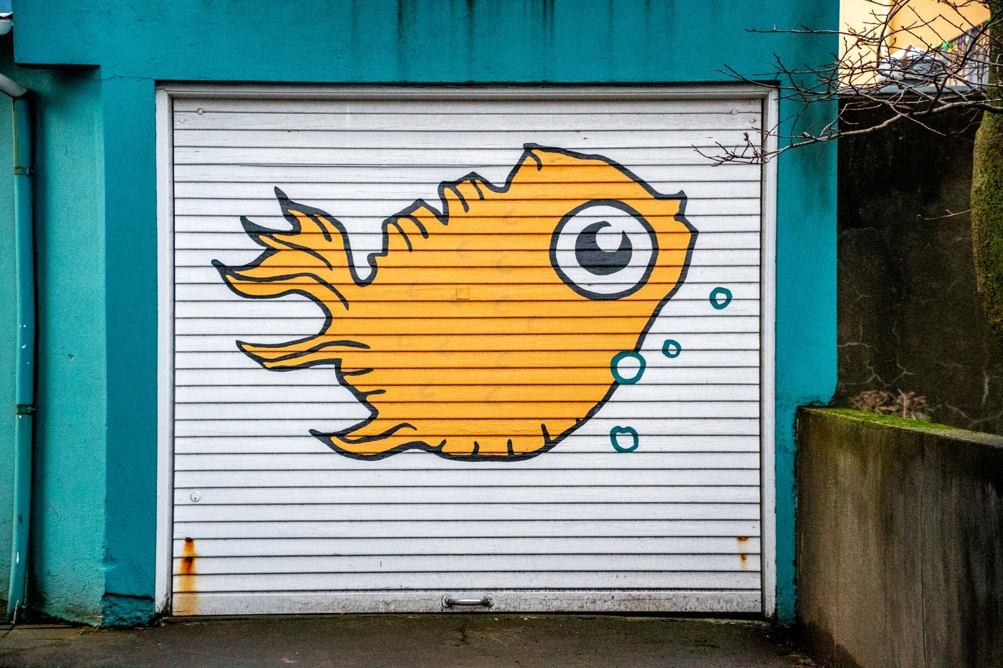 A fish mural in the shape of Iceland on a garage down in downtown Reykjavik.