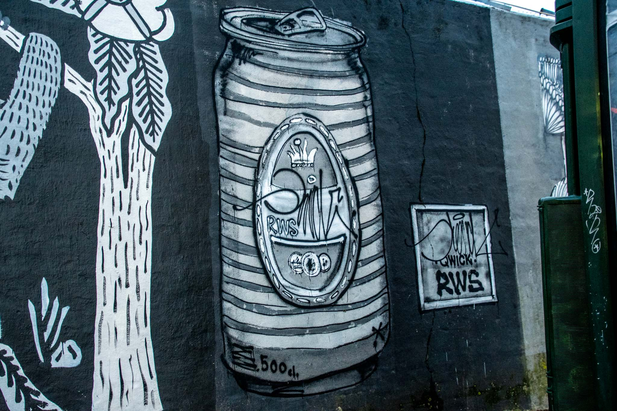 Street murals like this beer can are temporary and placed on construction sites.