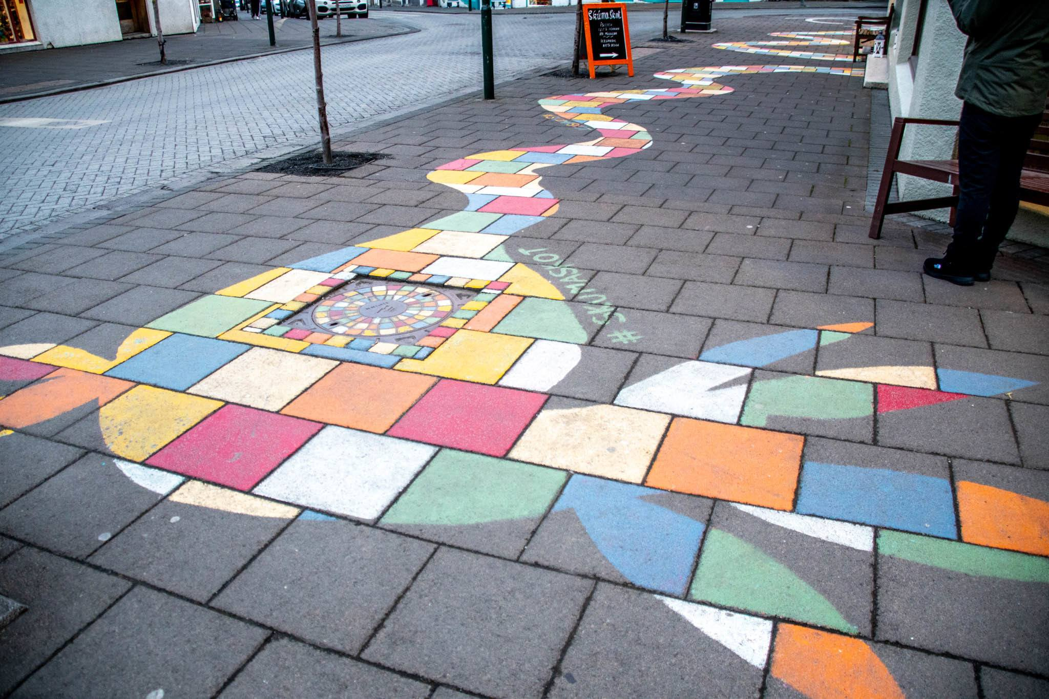 Iceland arts are both colorful and playful, as can be seen in this sidewalk art.