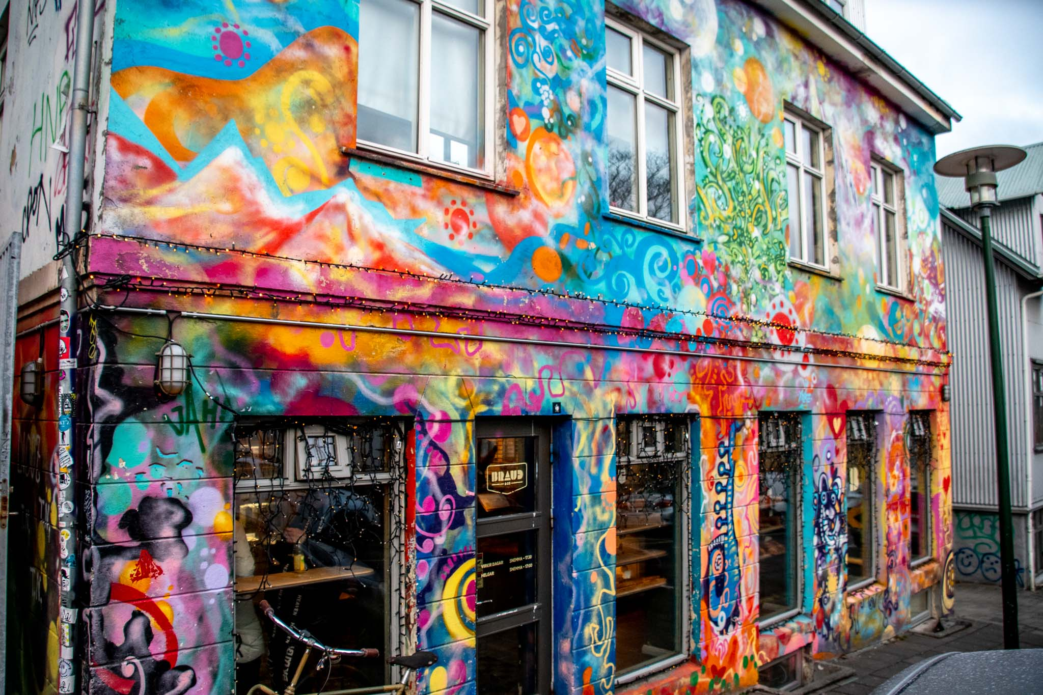Businesses hire wall muralists to decorate their premises, such as Braud & Co.