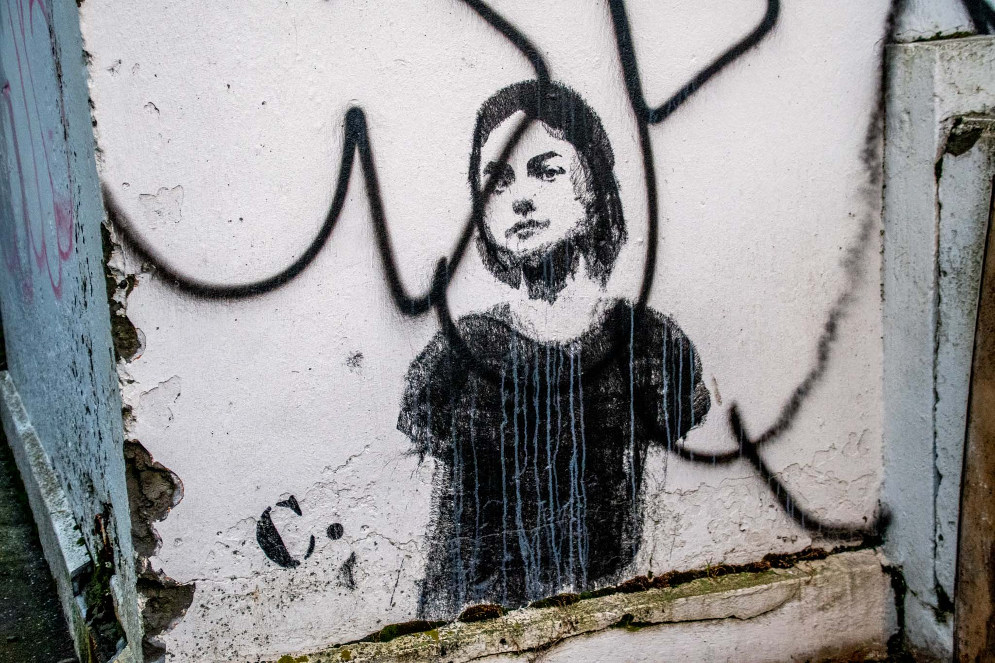 Street art stencil works like this young girl are seen in the Icelandic capital