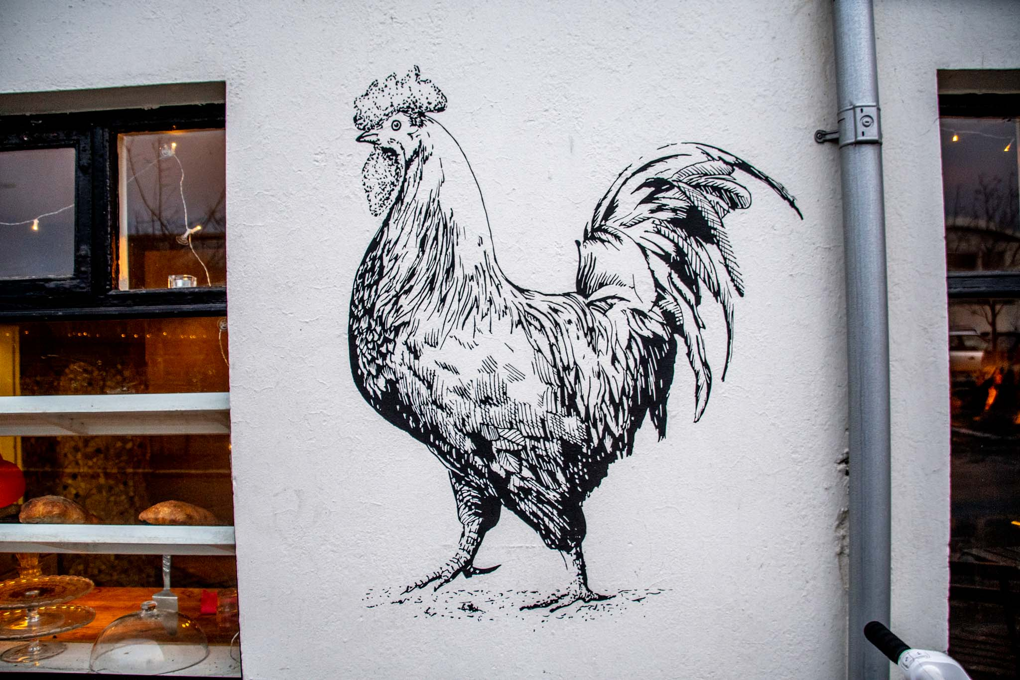 A rooster mural on a Reykjavik street.