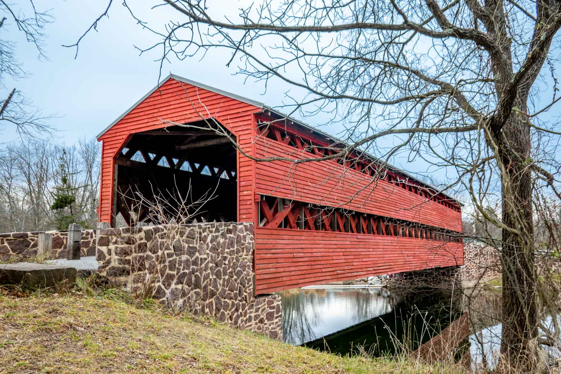 Sachs Covered Bridge, a red covered bridge over a creek in Gettysburg PA