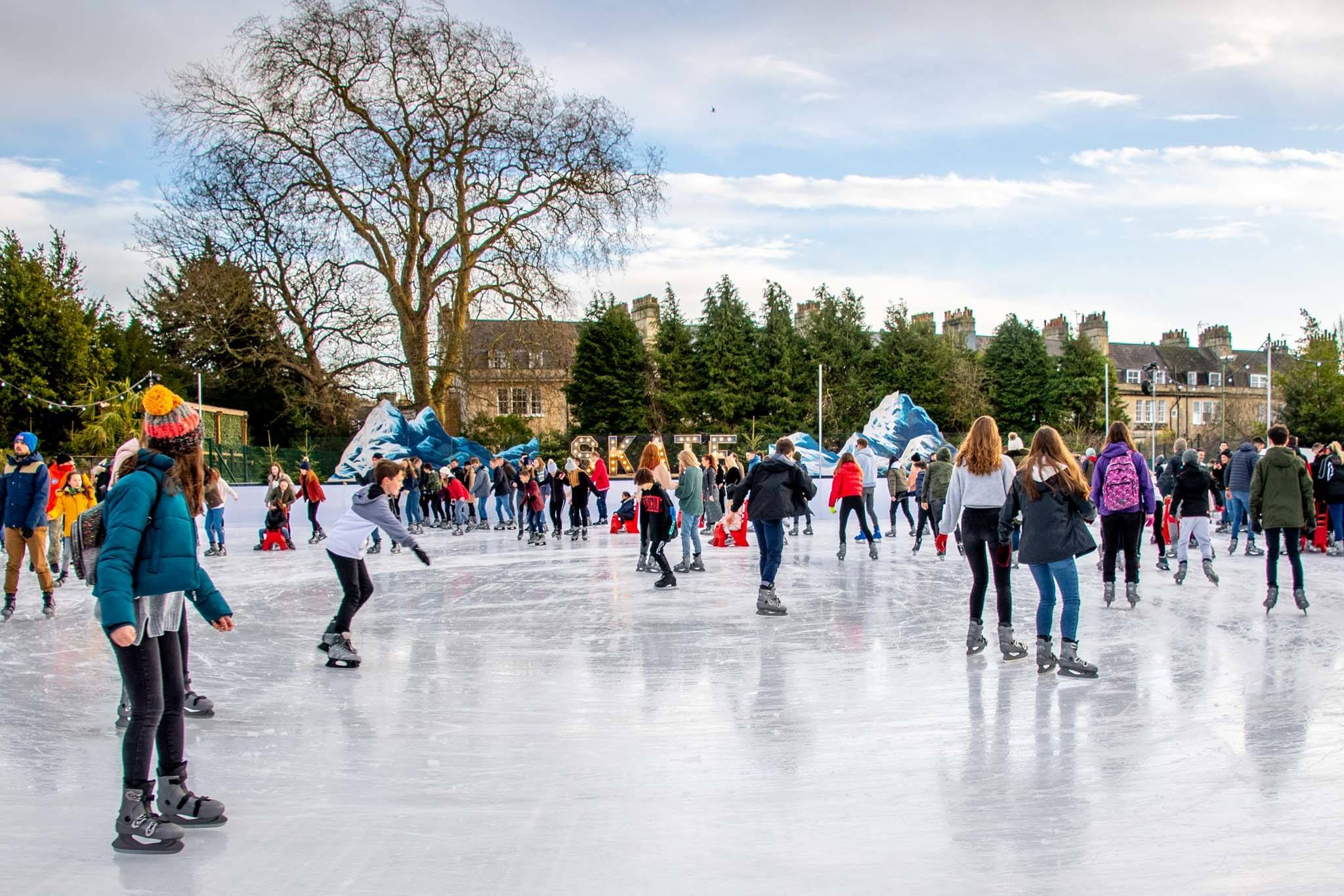 Skaters on ice-skating rink