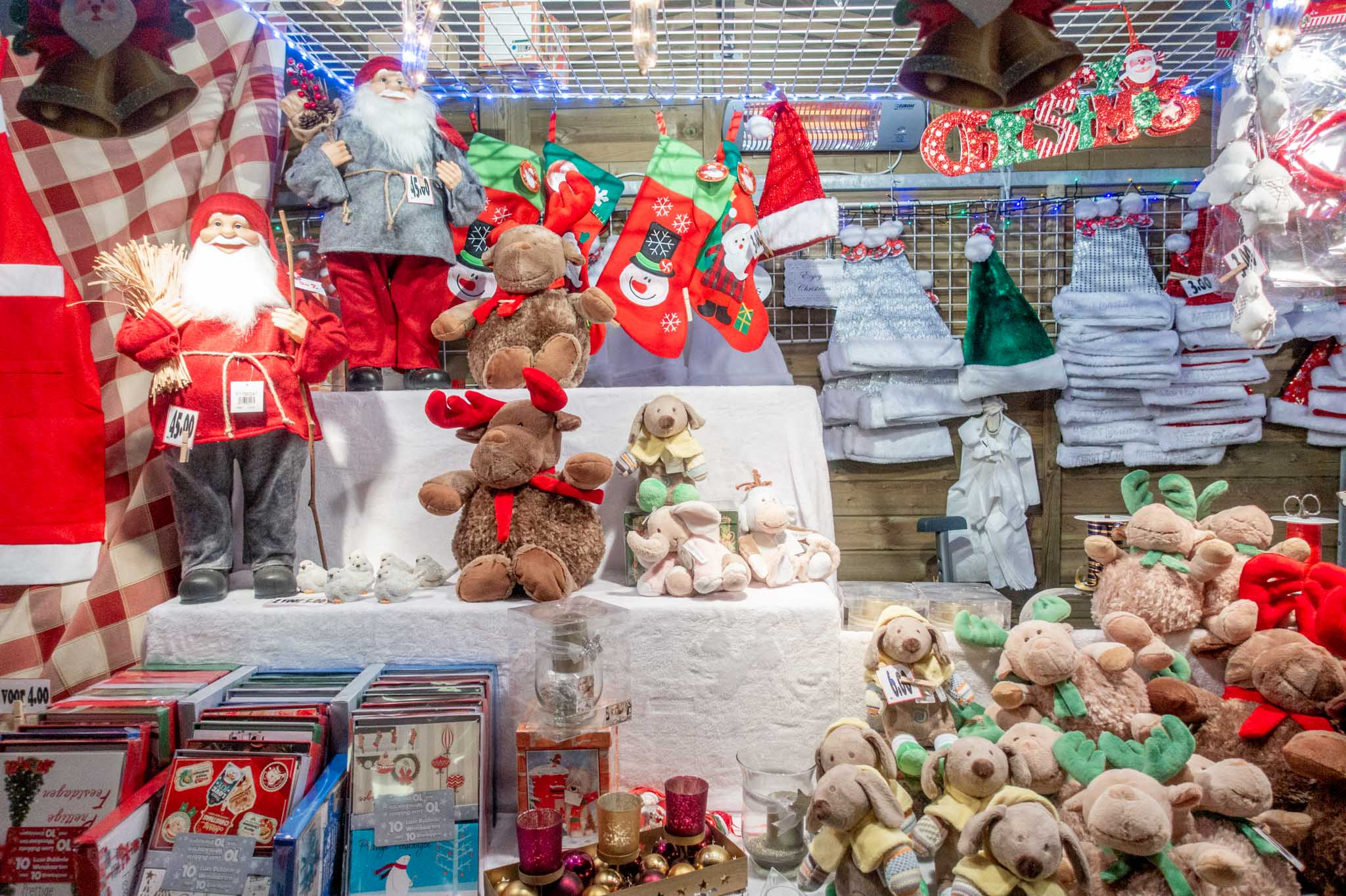 Stuffed animals, Santa hats, and other items for sale at the Bruges Xmas market