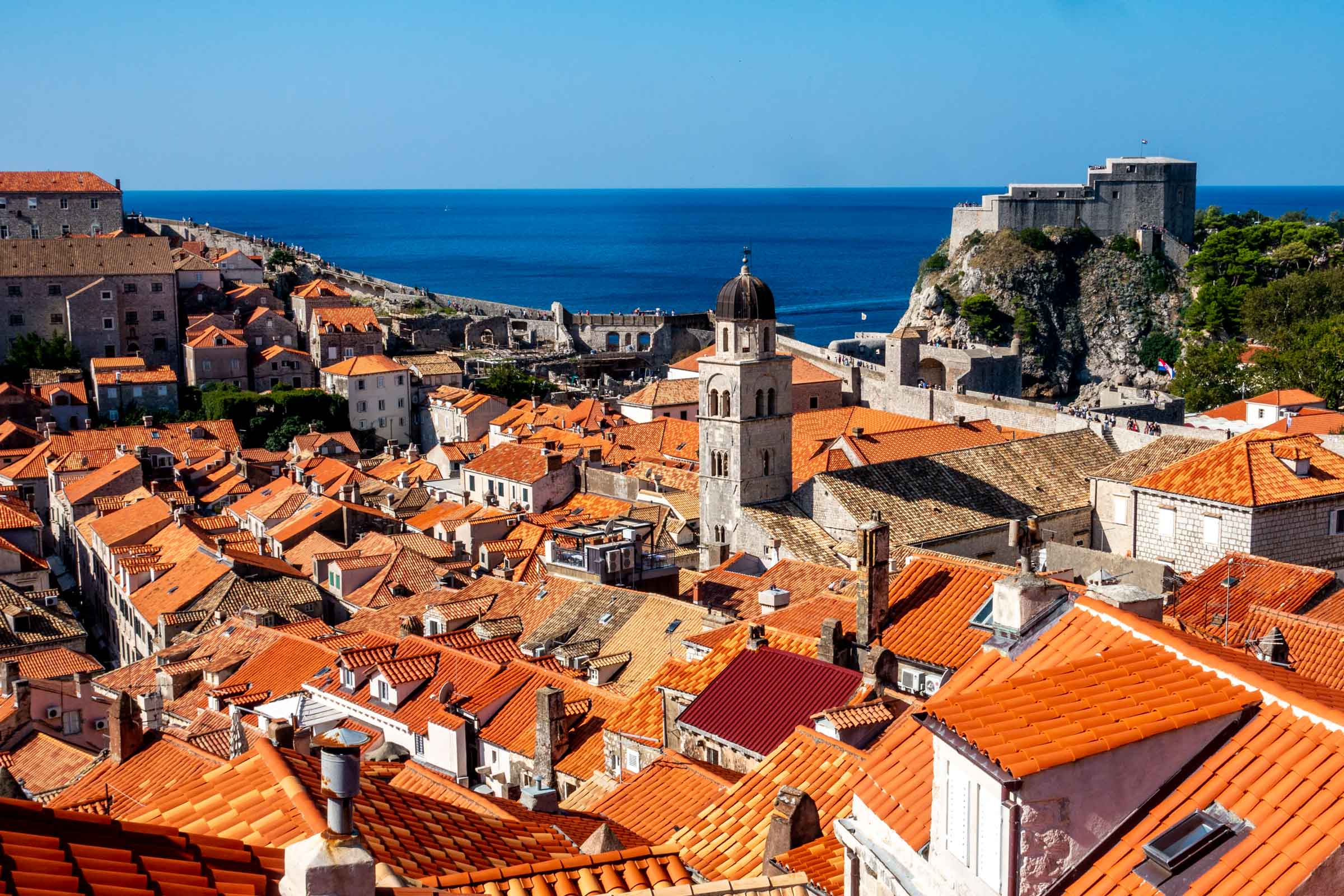 Red roofs of Dubrovnik, Croatia, with the ocean in the distance