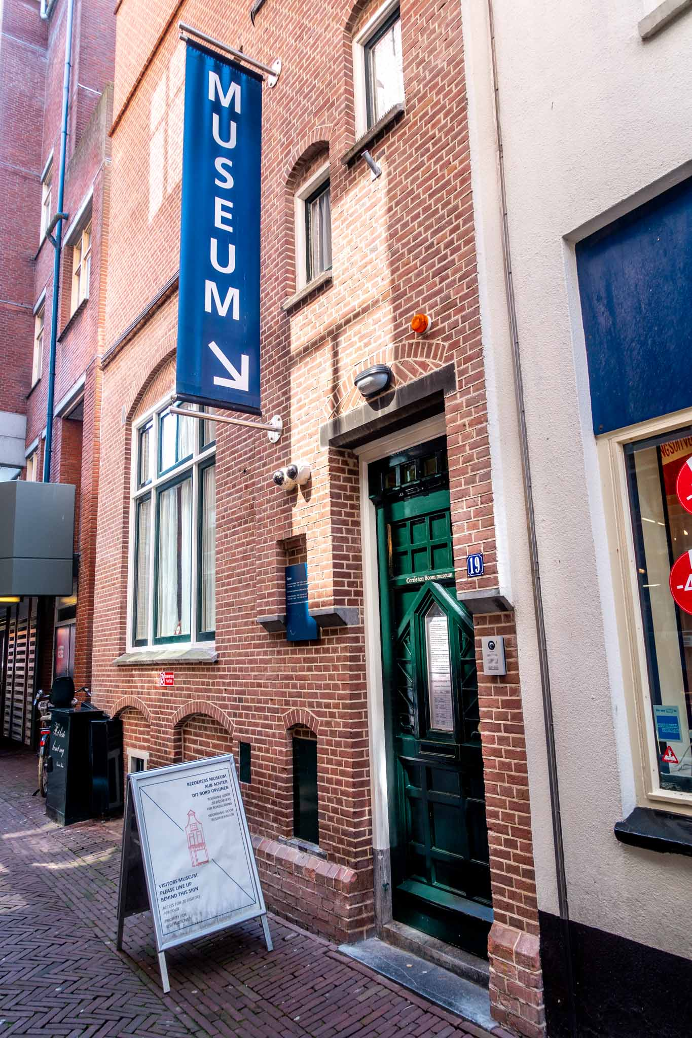 "Exterior of a building with a sign that says ""Museum"" outside the Corrie ten Boom House in Haarlem"