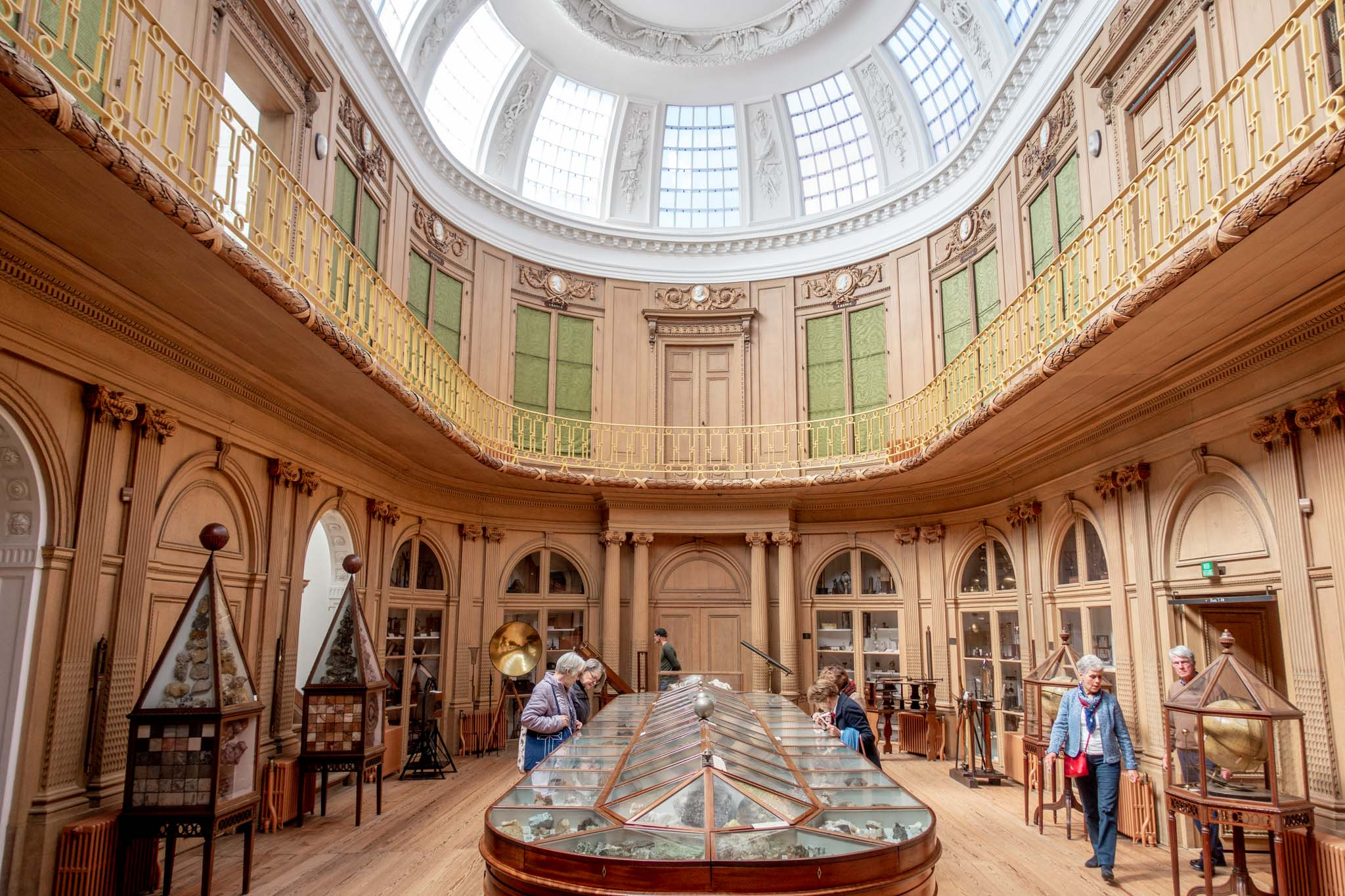 Oval Room with display case in the middle at Teylers Museum
