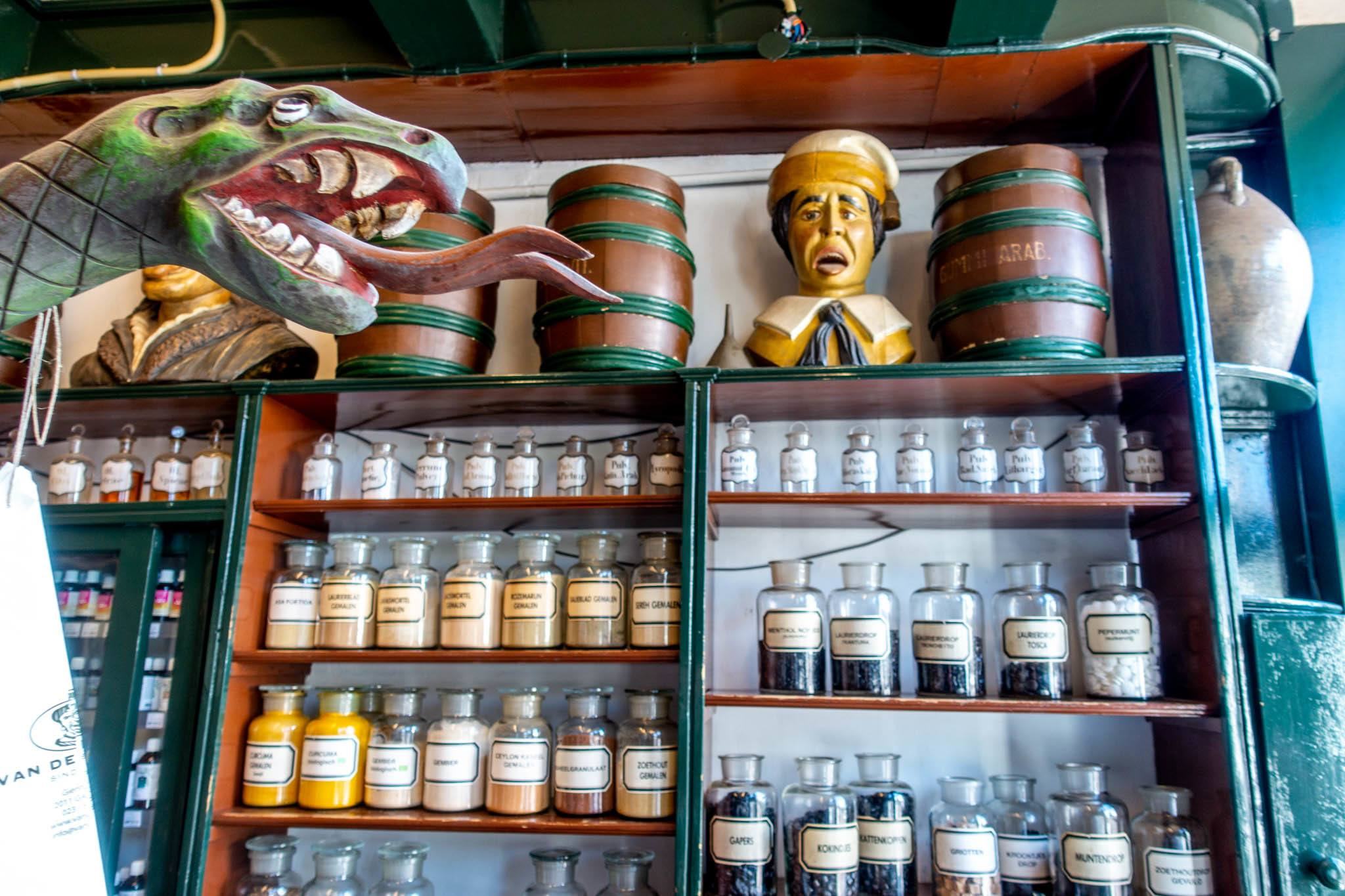 Apothecary bottles on shelves inside old-time pharmacy