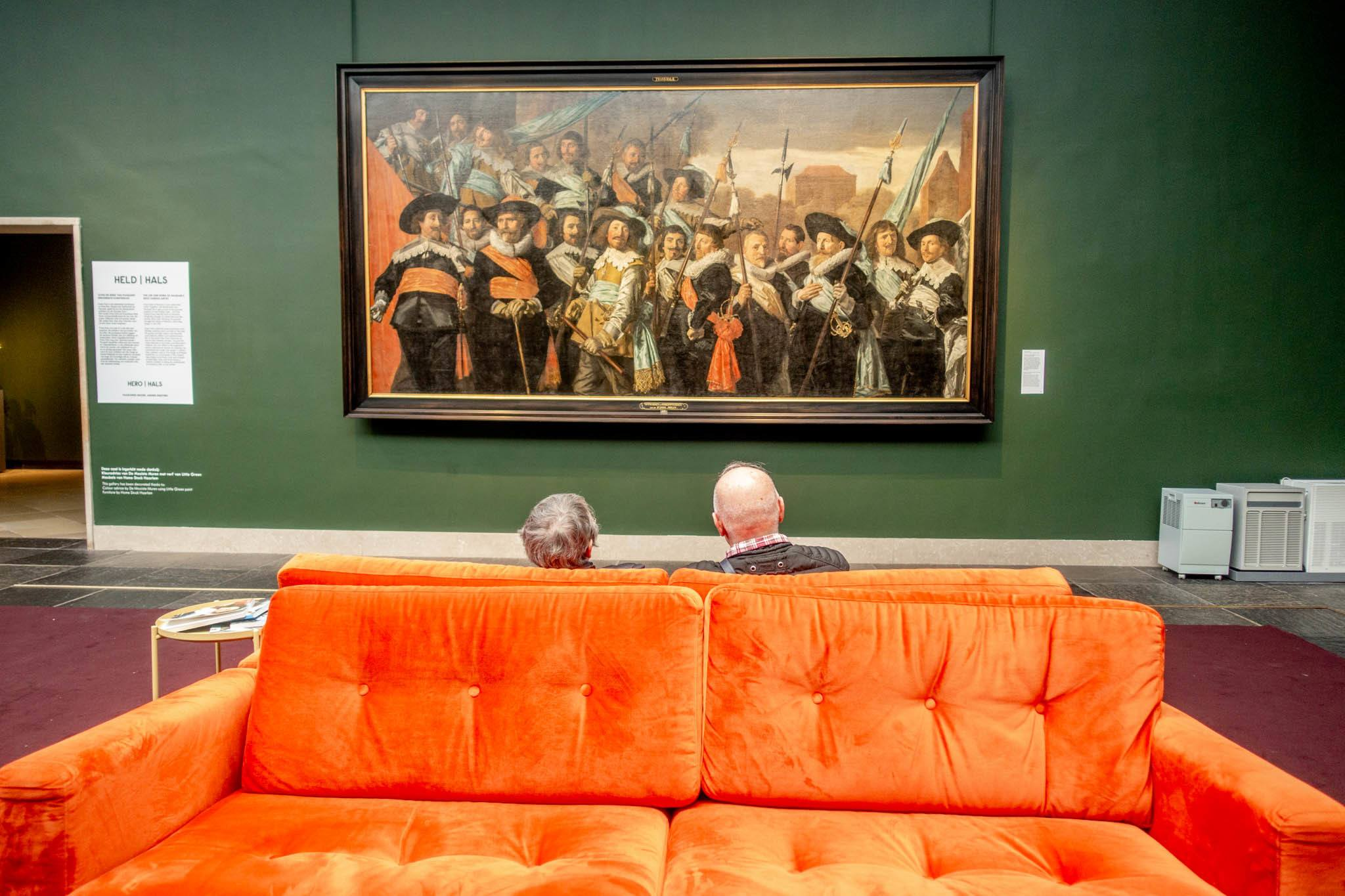 Seated couple looking at painting at Frans Hals Museum